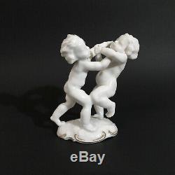 Antique, porcelain figurine Fighting Cherubs. K. Tutter for Hutschenreuther